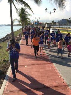 People walking together during the Caminata por la Ciencia on Amador Causeway, Panama City, Panama.