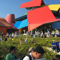 Science supporters walking down the BIOMUSEO' gardens. The BIOMUSEO is in the background. It is a colorful building desgigned by Frank Gehry.