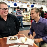JMU undergraduates Charles Boyd and Chase Collins celebrate their first conference presentation with cannolis
