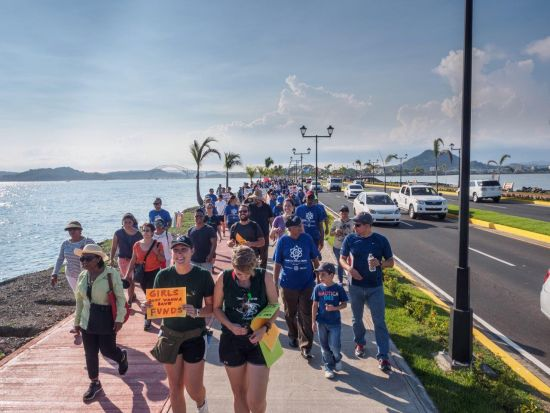 Supporters of science walking together during the Caminata por la Ciencia on Amador Causeway, Panama City, Panama.