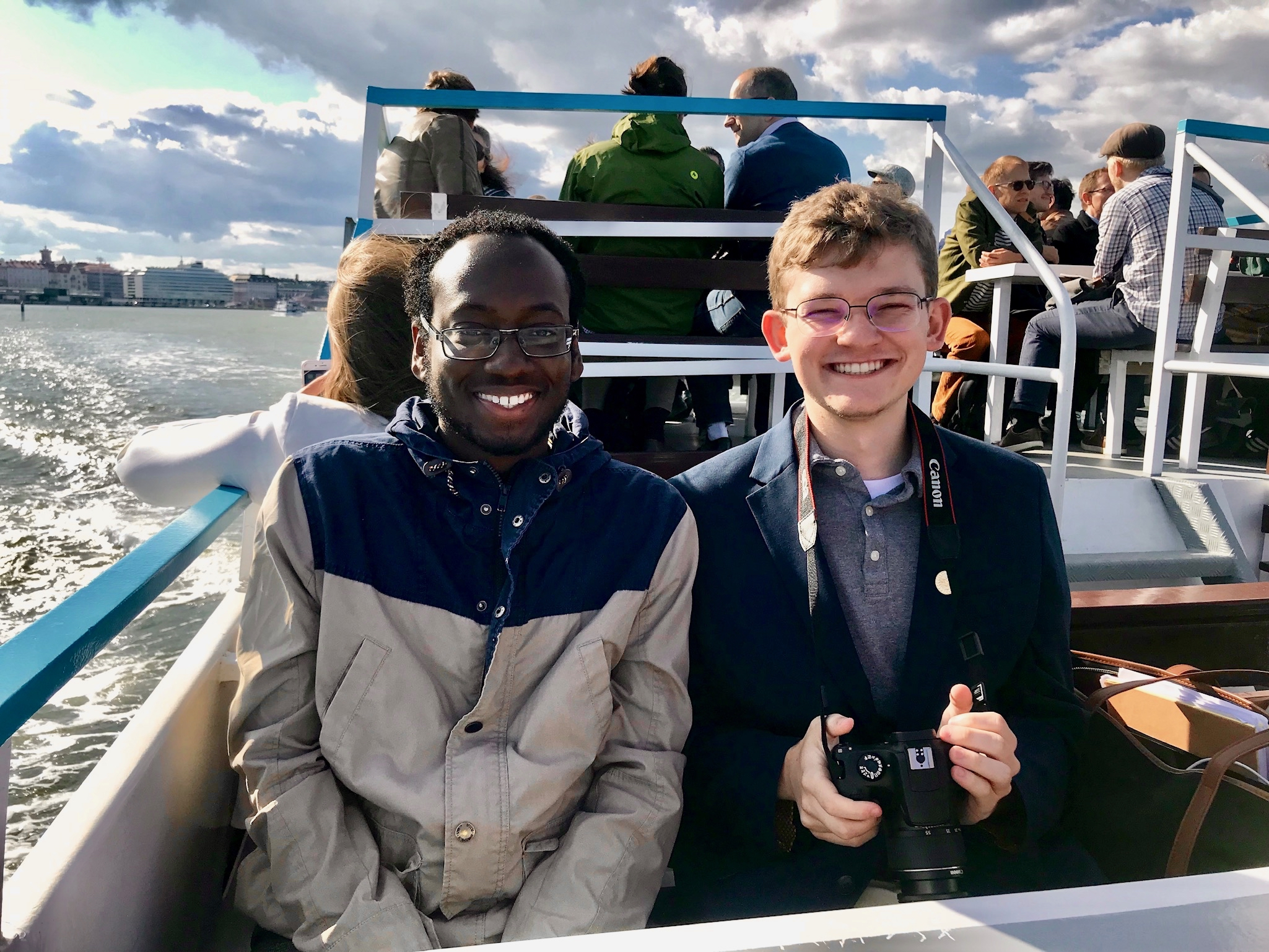 Two undergraduate STEM student members of the STS Futures Lab on a ferry in Helsinki, where they co-presented STS research with Lab co-PIs Emily York and Shannon N. Conley