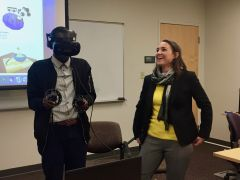 An undergraduate student member of the STS Futures Lab tries out the virtual reality headset
